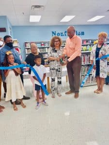 ribbon cutting to change name of school